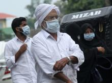 People wear safety masks as a precautionary measure after the 'Nipah' virus outbreak, at Kozhikode Medical College, in Kerala, on Saturday. PTI Photo