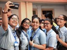 Students celebrate their success after CBSE declared its class 12th results, in Navi Mumbai
