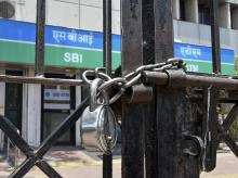 A closed SBI branch as the bank employees' went on a two-day nationwide strike to press for wage revision, in Bhopal on Wednesday, May 30, 2018.