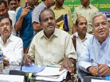 Karnataka Chief Minister H D Kumaraswamy, his deputy G Parameshwara and Chief Secretary Ratnaprabha (L) during a meeting with the farmers on the issue of loan waiver, in Bengaluru on Wednesday, May 30, 2018.