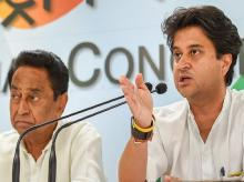 Senior Congress leader Jyotiraditya Scindia addresses a press conference as Congress Madhya Pradesh President Kamal Nath looks on, in New Delhi, on Sunday, June 03, 2018