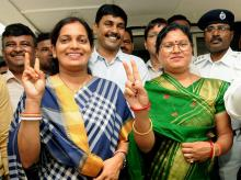 Newly elected MLAs Seema Mahato (L) of Silli and Babita Devi of Gomia flash the victory sign after their oath ceremony at Jharkhand Assembly in Ranchi on Tuesday, June 05, 2018.