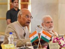 President Ram Nath Kovind speaks as Prime Minister Narendra Modi looks on, during the second day of the Conference of Governors at Rashtrapati Bhavan, in New Delhi on Tuesday, June 05, 2018. (