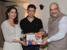 BJP President Amit Shah meets Bollywood actress Madhuri Dixit and Sriram Nene at their Juhu residence, as a part of his 'Sampark Se Samarthan' campaign, in Mumbai on Wednesday, June 06, 2018.