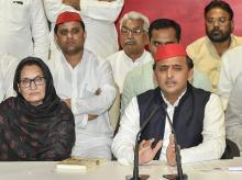 Samajwadi Party chief Akhilesh Yadav with newly elected Rashtriya Lok Dal's MP from Kairan, Begum Tabassum Hasan (L) adresses a press conference, in Lucknow on Wednesday, June 06, 2018.