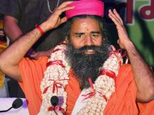 Swami Ramdev after being offered a 'Makhana-garland' during a function, in Patna