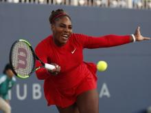 Serena Williams, of the United States, returns the ball to Johanna Konta, from Britain, during the Mubadala Silicon Valley Classic tennis tournament in San Jose
