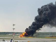 smoke rises from fire on a plane at Moscow's Sheremetyevo airport