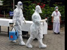 Medics collect Swab sample of COVID-19 patients and walk towards Laboratory at Mahendra Mohan Choudhury Hospital (MMCH), during the ongoing nationwide COVID-19 lockdown in Guwahati on Wednesday.
