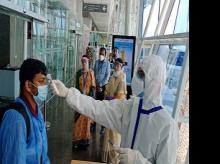 Air passengers being screened after arriving at Indore Airport