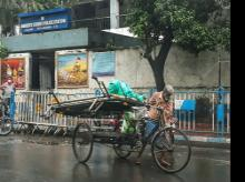 A rickshaw puller carries barricade in his cart during a rainfall, in Kolkata Photo: ANI