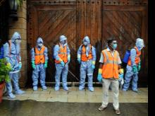 BMC Workers wearing PPE suit