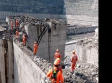 NDRF team search at barrage as rescue operations continue, in Chamoli district on Sunday.