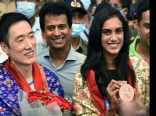 Olympic medallist PV Sindhu and her coach Park Tae Sang arrive at Rajiv Gandhi International Airport, in Hyderabad on Wednesday.